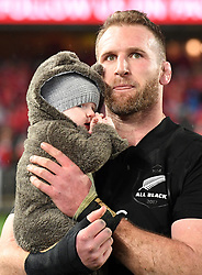 Keiran Read of New Zealand with his son Rueben before receiving his 100th test cap played against the Lions in the third International rugby test match between the the New Zealand All Blacks and British and Irish Lions at Eden Park, Auckland, New Zealand, Saturday, July 08, 2017. Credit:SNPA / Ross Setford  **NO ARCHIVING""