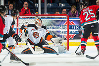 KELOWNA, BC - NOVEMBER 8: Mads Søgaard #30 of the Medicine Hat Tigers defends the net for a shot by Kobe Mohr #25 of the Kelowna Rockets  at Prospera Place on November 8, 2019 in Kelowna, Canada. (Photo by Marissa Baecker/Shoot the Breeze)