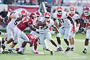 LITTLE ROCK, AR - OCTOBER 18:  Nick Chubb #27 of the Georgia Bulldogs runs the ball against the Arkansas Razorbacks at War Memorial Stadium on October 18, 2014 in Little Rock, Arkansas.  The Bulldogs defeated the Razorbacks 45-32.  (Photo by Wesley Hitt/Getty Images) *** Local Caption *** Nick Chubb