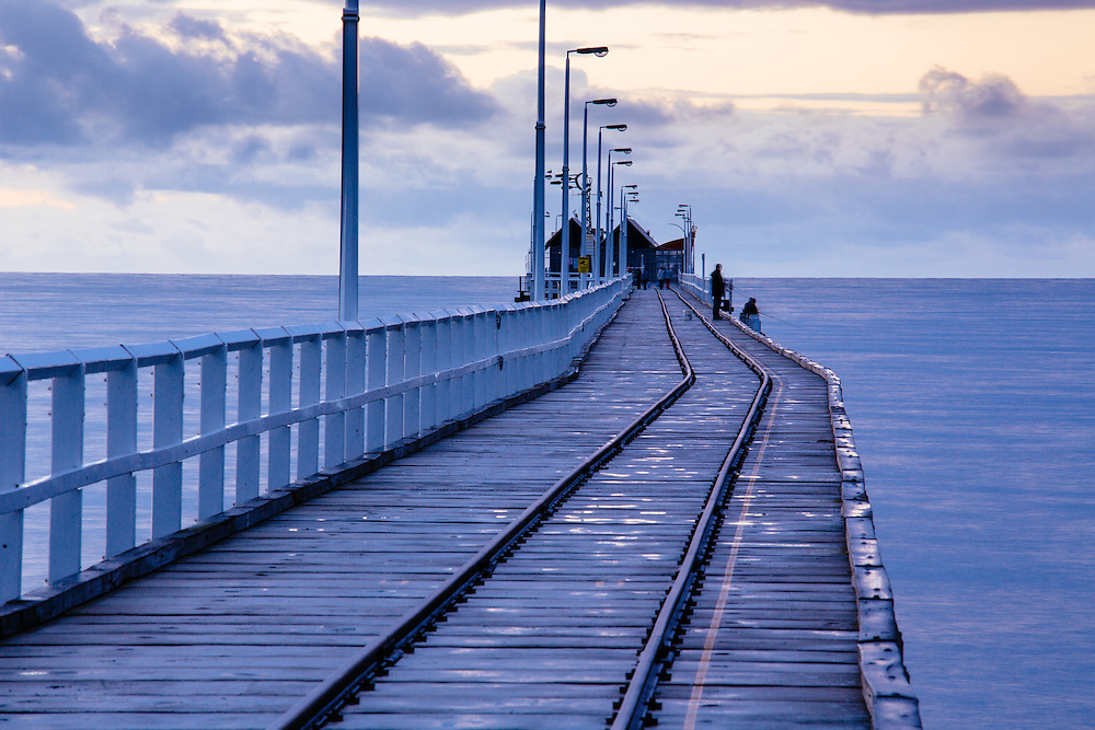 The last section of the Busselton Jetty with its rail line and timber structure.