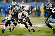 New Orleans Saints wide receiver Brandin Cooks (10) gets gang tackled by Carolina Panthers strong safety Tre Boston (33), Carolina Panthers middle linebacker Luke Kuechly (59), and Carolina Panthers defensive back Colin Jones (42) during the NFL week 9 regular season football game against the Carolina Panthers on Thursday, Oct. 30, 2014 in Charlotte, N.C. The Saints won the game 28-10. ©Paul Anthony Spinelli