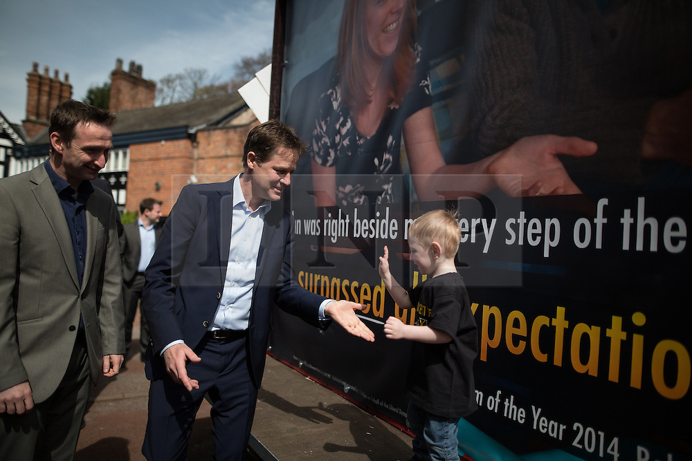 © Licensed to London News Pictures . 01/05/2015 . Manchester , UK . NICK CLEGG asking the son of a party activist to give him five after speaking at a Liberal Democrat party rally at Chorlton-cum-Hardy Golf Club . Liberal Democrat party leader Nick Clegg visits the constituency of Manchester Withington to deliver a speech on the NHS and campaign with local candidate John Leech . Photo credit : Joel Goodman/LNP
