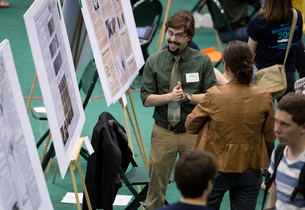 Ohio University student Ben Gahagen speaks with a visitor to the Ohio University Student Expo in the convocation center on April 10, 2014. Photo by Lauren Pond