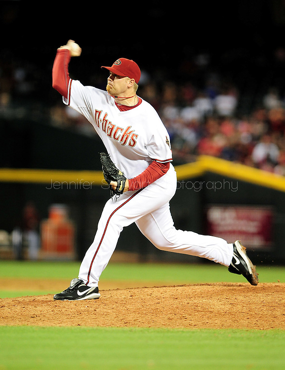Sep. 27 2011; Phoenix, AZ, USA; Arizona Diamondbacks pitcher J.J. Putz (40) delivers a pitch during the ninth inning against the Los Angeles Dodgers at Chase Field. The Diamondbacks defeated the Dodgers 7-6 in extra innings.  Mandatory Credit: Jennifer Stewart-US PRESSWIRE.