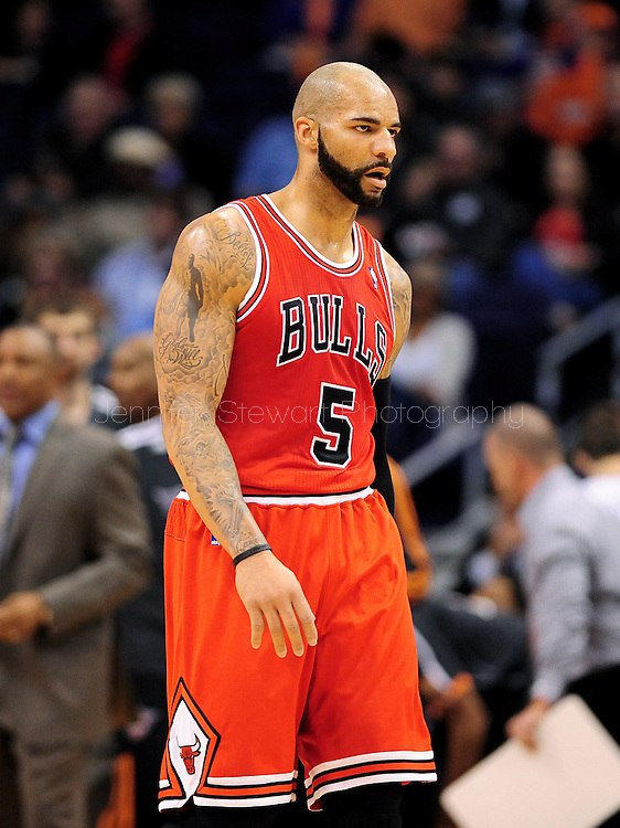 Nov. 14, 2012; Phoenix, AZ, USA; Chicago Bulls forward Carlos Boozer (5) walks up the court during the game against the Phoenix Suns at the US Airways Center. The Bulls defeated the Suns 112-106 in overtime. Mandatory Credit: Jennifer Stewart-USA TODAY Sports