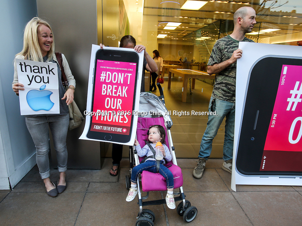 Demonstrators hold up signs during a rally in support of data privacy outside the Apple store, Tuesday, Feb. 23, 2016, in Los Angeles. Protesters assembled in more than 30 cities around the world to lash out at the FBI for obtaining a court order that requires Apple to make it easier to unlock an encrypted iPhone used by a gunman in December's mass murders in California.(Photo by Ringo Chiu/PHOTOFORMULA.com)<br /> <br /> Usage Notes: This content is intended for editorial use only. For other uses, additional clearances may be required.