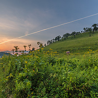 Jet trail at sunset on the prairie