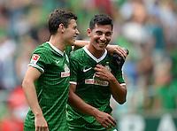 FUSSBALL   1. BUNDESLIGA   SAISON 2013/2014   TESTSPIEL  SV Werder Bremen - FC Fulham         28.07.2013 Zlatko Junuzovic (li) und Oezkan Yildirim (v.l., alle SV Werder Bremen) freuen sich nach dem Abpfiff