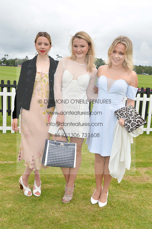 Left to right, GRETA BELLAMACINA,  AMBER ATHERTON and POPPY JAMIE at the Cartier Queen's Cup Final polo held at Guards Polo Club, Smith's Lawn, Windsor Great Park, Egham, Surrey on 15th June 2014.