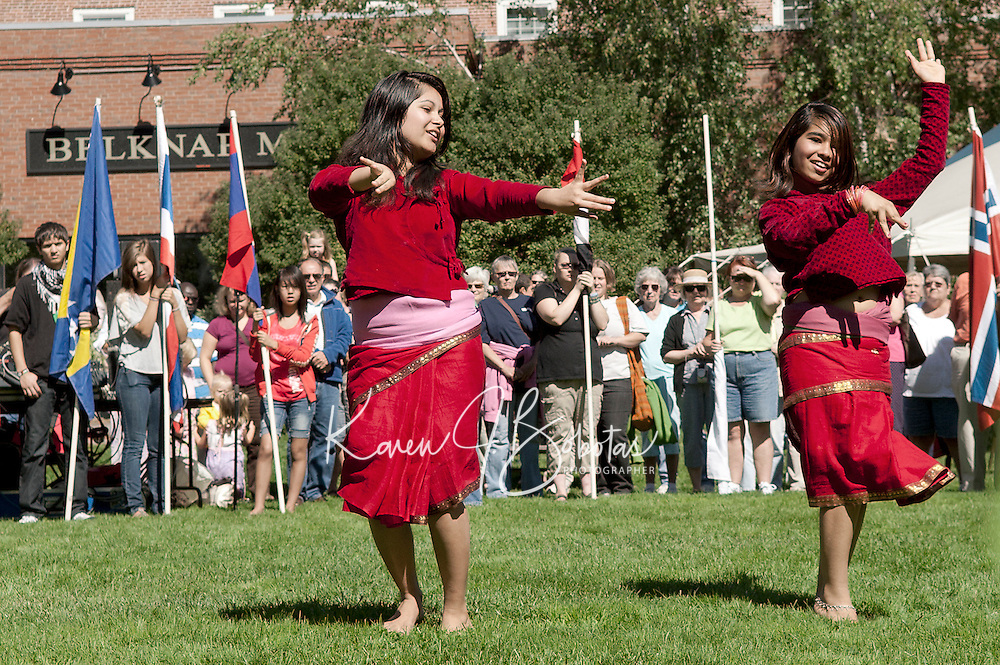 Champa and Anjana Dulal perform a traditional Nepali dance in Rotary Park during the annual Multicultural Market Day festivities.  (Karen Bobotas/for the Laconia Daily Sun)
