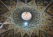 Stunning photographs reveal the beautiful ceilings in Iran's mosques, bazaars and public baths<br /> <br /> For the past few decades, restrictions on travel to Iran has meant the country has been largely shut off from the Western world, but as visa sanctions are lifted in the light of a landmark nuclear deal, the local tourism industry is hoping for a flurry of visitors.<br /> It's not hard to see why Iran is listed as one of the top travel destinations of 2016, with its rich culture and history. <br /> Among the standout aspects of the nation is its beautiful ancient architecture, with the cities and towns littered with ornate and eye-catching mosques, public baths and markets. <br /> And unlike many other countries - the roof is not an afterthought, with many ceilings built as the centrepiece to the building, with many of the tile designs showcasing a display of intricate geometric patterns that date back several centuries. <br /> French photographer Eric Lafforgue has travelled the country photographing the ceilings of indoor markets, mosques and bath houses. <br /> <br /> Photo shows: Ceiling With Its Intricate And Elaborate Patterns And Internal Stainless Glass Dome In Sultan Amir Ahmad Bathhouse Ceiling