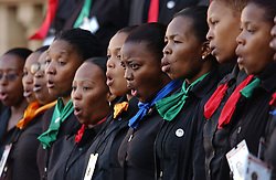 PRETORIA, SOUTH AFRICA - APRIL-27-2004 -A choir performs during the inauguration ceremony for South African President Thabo Mbeki , which marks the 10th Anniversary of the fall of Apartheid in South Africa. (PHOTO © JOCK FISTICK)