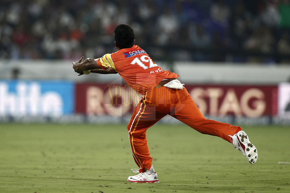 Asif Raza of the LAHORE LIONS drop the catch of Robin Uthappa of the Kolkata Knight Riders during match 7 of the Oppo Champions League Twenty20 between the Kolkata Knight Riders and the Lahore Lions held at the Rajiv Gandhi Cricket Stadium, Hyderabad, India on the 21st September 2014<br /> <br /> Photo by:  Deepak Malik / Sportzpics/ CLT20<br /> <br /> <br /> Image use is subject to the terms and conditions as laid out by the BCCI/ CLT20.  The terms and conditions can be downloaded here:<br /> <br /> http://sportzpics.photoshelter.com/gallery/CLT20-Image-Terms-and-Conditions-2014/G0000IfNJn535VPU/C0000QhhKadWcjYs