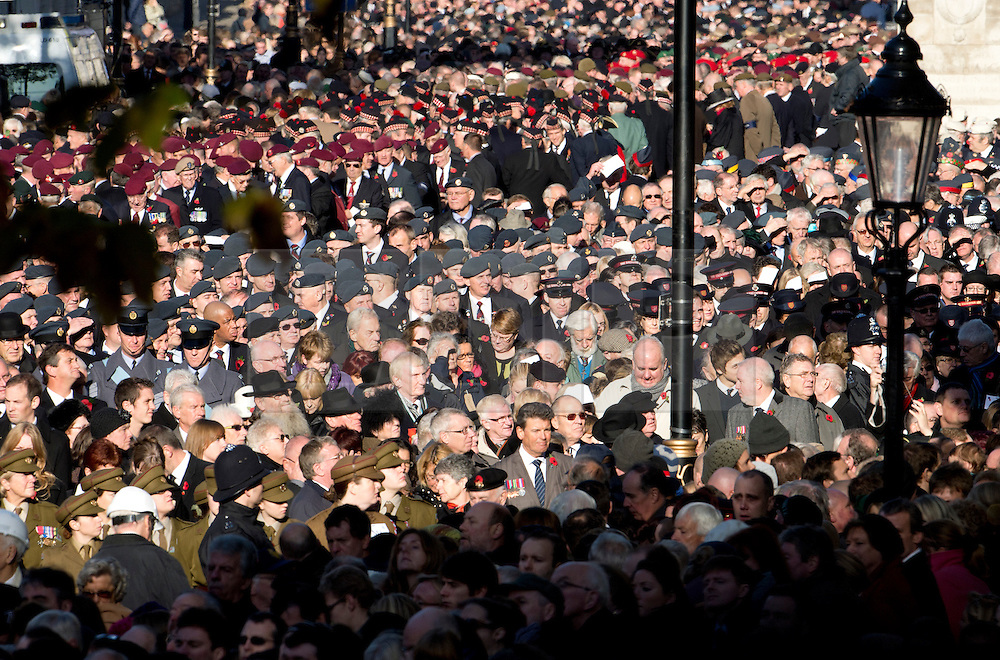 © London News Pictures. 11/11/2012. London, UK. Members of the public and Servicemen fill whitehall in Westminster, London to watch the Remembrance Day Ceremony at the Cenotaph on November 11, 2012 in London, United Kingdom. Photo credit: Ben Cawthra/LNP