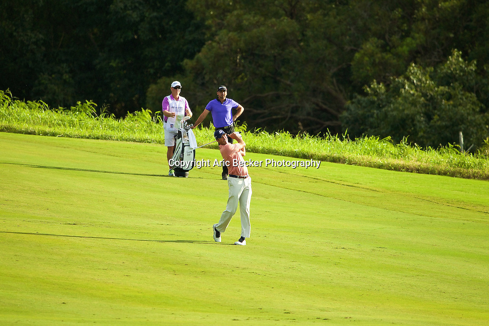 January 09 2015:  Matt Kuchar hits his second shot on number eighteen during the First Round of the Hyundai Tournament of Champions at Kapalua Plantation Course on Maui, HI.