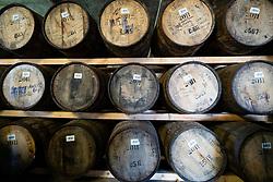 Whisky barrels at Deanston Distillery in Doune, Scotland, UK