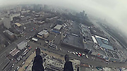 Mission Insanity: Russian daredevils' reveal meticulous plan which helped them climb to the top of Europe's tallest building (where the temperature is always below freezing)<br /> <br /> Scaling a 1,000ft building takes a lot of courage and skill. Add breaking and entering, mapping CCTV systems, hiding from Russian security guards and you have a mission bordering on insanity.<br /> Mercury City Tower, an office and residential building in central Moscow, Russian, is set to be the tallest building in Europe - once it is finished. <br /> Using a plan fit for Mission Impossible, a team of Russian daredevils braved violent guards, cameras and the freezing cold to climb 1,214ft to tip of a construction crane on top of the building.<br /> Mercury City is in its final stages and the construction site is protected by a multi-level security system which includes cameras, motion detectors and guards, not to mention the 'real-life anthill' of construction workers who, according to climber Vitaliy Raskalov, will not only ring the alarm but also 'beat you up really badly'.<br /> 'There is no legal way for regular guys to get upstairs', says roof climber Raskalov as he unveils the plan.<br /> In their mission to conquer Mercury City, Raskalov and his four team members had been watching the site for weeks, resulting in a perfect plan to avoid detection.<br /> The group mapped all the security camera system's blind spots as well as worked out the walking paths of the security guards.<br /> <br /> Following their plan, the crew sneak inside the building site dressed as construction workers and are forced to hide behind corners from patrolling security before climbing up 75 flights of stairs to get to the top floor.<br /> But for Mr Raskalov and his friends that was never going to be enough. Determined to reach higher than anyone before them, they had their eyes set on the dangerously unstable construction crane on top of the building, adding another 104ft to their climb.<br /> Deemed a mission too dangerous whilst the crane is in operation, the team hav