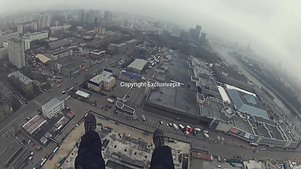 Mission Insanity: Russian daredevils' reveal meticulous plan which helped them climb to the top of Europe's tallest building (where the temperature is always below freezing)<br /> <br /> Scaling a 1,000ft building takes a lot of courage and skill. Add breaking and entering, mapping CCTV systems, hiding from Russian security guards and you have a mission bordering on insanity.<br /> Mercury City Tower, an office and residential building in central Moscow, Russian, is set to be the tallest building in Europe - once it is finished. <br /> Using a plan fit for Mission Impossible, a team of Russian daredevils braved violent guards, cameras and the freezing cold to climb 1,214ft to tip of a construction crane on top of the building.<br /> Mercury City is in its final stages and the construction site is protected by a multi-level security system which includes cameras, motion detectors and guards, not to mention the 'real-life anthill' of construction workers who, according to climber Vitaliy Raskalov, will not only ring the alarm but also 'beat you up really badly'.<br /> 'There is no legal way for regular guys to get upstairs', says roof climber Raskalov as he unveils the plan.<br /> In their mission to conquer Mercury City, Raskalov and his four team members had been watching the site for weeks, resulting in a perfect plan to avoid detection.<br /> The group mapped all the security camera system's blind spots as well as worked out the walking paths of the security guards.<br /> <br /> Following their plan, the crew sneak inside the building site dressed as construction workers and are forced to hide behind corners from patrolling security before climbing up 75 flights of stairs to get to the top floor.<br /> But for Mr Raskalov and his friends that was never going to be enough. Determined to reach higher than anyone before them, they had their eyes set on the dangerously unstable construction crane on top of the building, adding another 104ft to their climb.<br /> Deeme