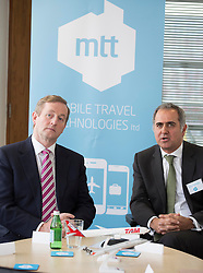 Repro Free: 20/02/2014<br /> An Taoiseach, Enda Kenny TD, is pictured at the opening of Mobile Travel Technologies Ltd (MTT) new office at Grand Canal Dublin, with Gerry Samuels, CEO, MTT, as it expand it&rsquo;s sophisticated mobile solutions business. Picture Andres Poveda