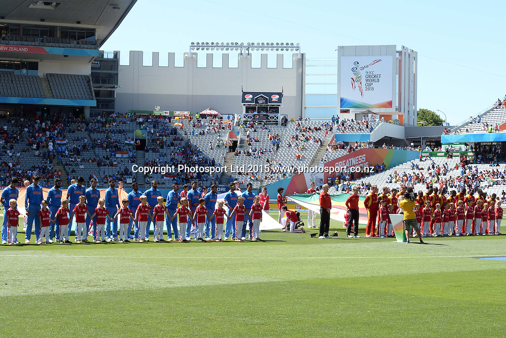 Teams India and Zimbabwe lineup for their national anthems during the ICC Cricket World Cup match between India and Zimbabwe at Eden Park in Auckland, New Zealand. Saturday 14 March 2015. Copyright Photo: Raghavan Venugopal / www.photosport.co.nz
