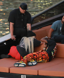 """EXCLUSIVE: Kylie Jenner goes back to being a blonde (like she was with X-Boyfriend Tyga) seen here are the first pictures of a very """"BLONDE"""" Kylie Jenner and her new boyfriend Jacques Webster, Jr. better know as hip-hop singer Travis Scott. The lovebirds arrived by yacht and dined in a private back room of the exclusive restaurant the River Yacht Club where Kylie and Travis looked very happy and were spotted kissing and being very romantic while bodyguards kept out unwanted people. The new couple had a blast at the exclusive waterside restaurant where they were joined by Miami-based restaurant, nightlife and hospitality entrepreneur David Grutman and his wife Isabela Rangel. While Kylie drank Evian water all night her new man Rapper Travis Scott was in full party mode and did a total of 17 shots of Don Julio 1942™- World's First Luxury Tequila with their friends. Perhaps the Tequila took its toll, as Travis looked a little under the weather on the boat ride home. The couple spent a total of $2000.00 with their friends and left a very generous additional $100.00 in addition to the 20% tip at The River Yacht Club Restaurant in Miami on May 7, 2017 in Miami, Florida. 07 May 2017 Pictured: Kylie Jenner, Travis-Scott. Photo credit: TBA / MEGA TheMegaAgency.com +1 888 505 6342"""