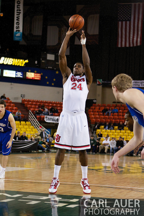 November 26th, 2010:  Anchorage, Alaska - St. John's senior forward Justin Burrell (24) puts up free throw in the Red Storm's semi final game of the Great Alaska Shootout against the Drake Bulldogs.  The Red Storm defense held Drake to a tournament low score as St. Johns advanced to the final game 82-39.