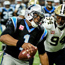 Oct 16, 2016; New Orleans, LA, USA; Carolina Panthers quarterback Cam Newton (1) runs past New Orleans Saints defensive end Cameron Jordan (94) for a touchdown during the fourth quarter of a game at the Mercedes-Benz Superdome. The Saints defeated the Panthers 41-38. Mandatory Credit: Derick E. Hingle-USA TODAY Sports