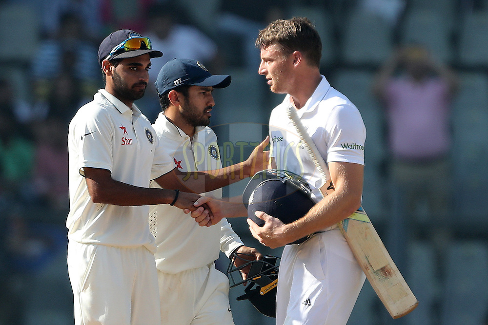 Bhuvneshwar Kumar of India  and Jos Buttler of England  shake after the match during day 5 of the fourth test match between India and England held at the Wankhede Stadium, Mumbai on the 12th December 2016.<br /> <br /> Photo by: Ron Gaunt/ BCCI/ SPORTZPICS