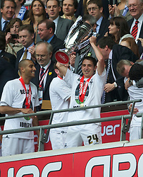 LONDON, ENGLAND - Saturday, May 30, 2011: Swansea City's Joe Allen lifts the trophy after his side beat Reading 4-2 after the Football League Championship Play-Off Final match at Wembley Stadium. (Photo by David Rawcliffe/Propaganda)