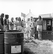 People lining up for pay phones, Glastonbury, Somerset, 1989