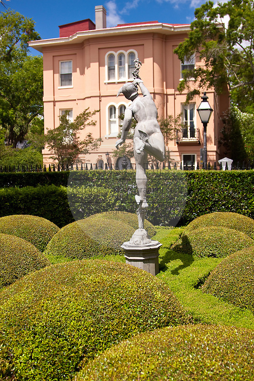 A statue of Mercury graces the formal gardens of the Calhoun Mansion built in 1876 at 16 Meeting Street in Charleston, South Carolina.