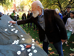 © Licensed to London News Pictures. 13/11/2011. London, UK. A man lays a white poppy on the memorial at the end of the service. Pledge Union White Poppy Remembrance Ceremony at the Conscientious Objectors Memorial in Tavistock Square Gardens today,  Sunday 13th Nov. Photo credit : Stephen Simpson/LNP
