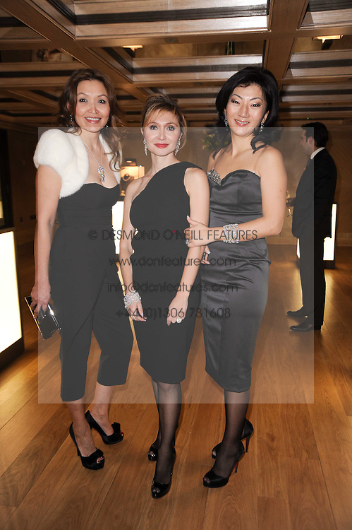 Left to right, MIRA DAMIANI - MD Damiani UK, SILVIA DAMIANI and ZHANNA KAN at a dinner hosted by jewellers Damiani at The Connaught Hotel, London on 3rd February 2010.