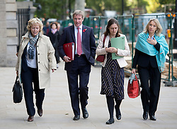 © London News Pictures. 29/10/2013 . London, UK.  TONY COCKER (second left), chief executive of E.ON UK, arriving at Portcullis house in Westminster, London where he and other bosses from the UK's leading energy companies are due to face questions from the Energy and Climate Change Committee about energy price rises. Photo credit : Ben Cawthra/LNP