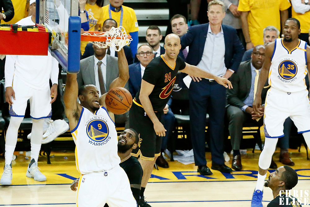 12 June 2017: Golden State Warriors forward Andre Iguodala (9) dunks the ball on Cleveland Cavaliers guard Kyrie Irving (2) during the Golden State Warriors 129-120 victory over the Cleveland Cavaliers, in game 5 of the 2017 NBA Finals, at the Oracle Arena, Oakland, California, USA.