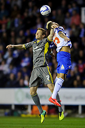 Dean Hammond (ENG) of Leicester City and Daniel Williams (USA) of Reading compete in the air - Photo mandatory by-line: Rogan Thomson/JMP - 07966 386802 - 14/04/2014 - SPORT - FOOTBALL - Madejski Stadium, Reading - Reading v Leicester City - Sky Bet Football League Championship.