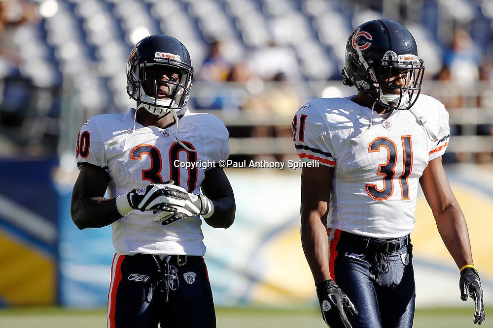Chicago Bears cornerback D.J. Moore (30) and rookie cornerback Joshua Moore (31) take a break during pregame warmups during a NFL week 1 preseason football game against the San Diego Chargers, Saturday, August 14, 2010 in San Diego, California. The Chargers won the game 25-10. (©Paul Anthony Spinelli)