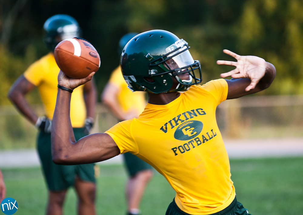 Central Cabarrus quarterback Hasaan Klugh looks to pass during drills at football practice Monday July 30 at Central Cabarrus High School. (photo by James Nix)