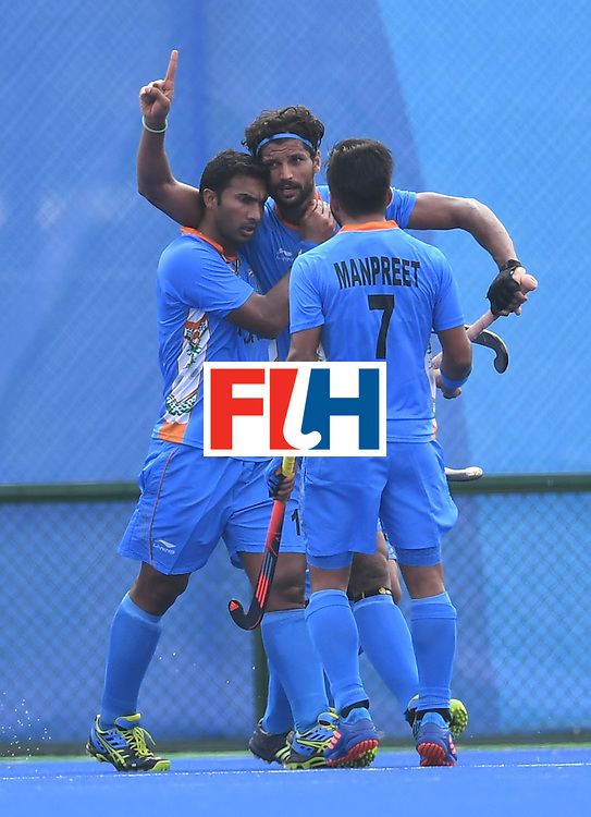 India's Rupinder Pal Singh (C) celebrates scoring a goal during the men's field hockey Germany vs India match of the Rio 2016 Olympics Games at the Olympic Hockey Centre in Rio de Janeiro on August, 8 2016. / AFP / MANAN VATSYAYANA        (Photo credit should read MANAN VATSYAYANA/AFP/Getty Images)