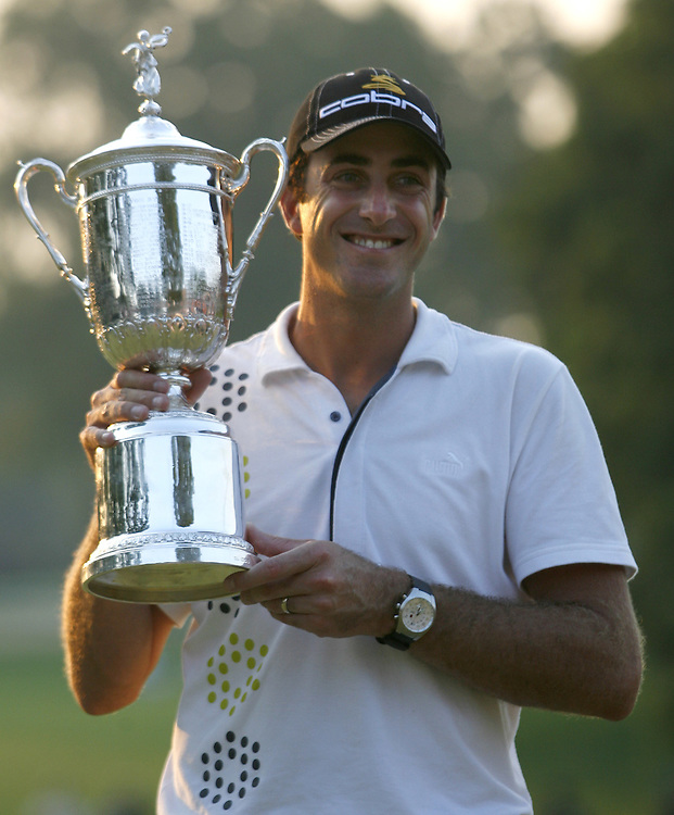 Geoff Oglivy of Australia holds the US Open Championship trophy after winning the US Open Golf Championship at Winged Foot Golf Club in Mamaroneck, New York Sunday, 18 June 2006. .