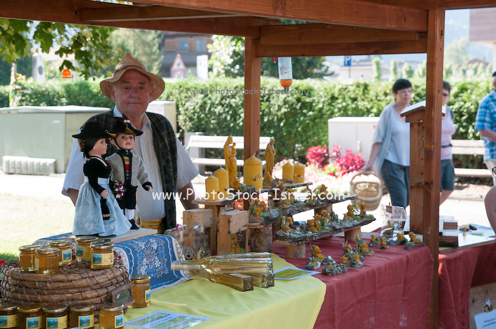 selling honey and bee wax products at a Farmer's market, Zell am Ziller, Tyrol, Austria