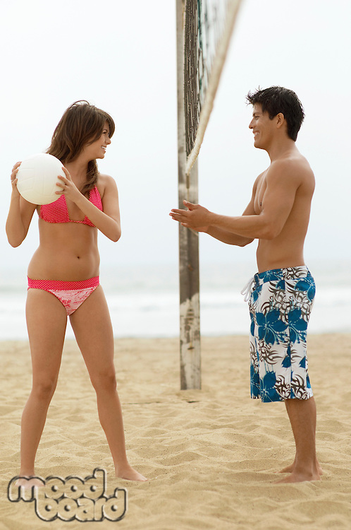 Young Woman Teasing Boyfriend on Beach