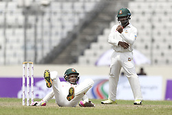 August 28, 2017 - Mirpur, Bangladesh - Bangladesh's Mushfiqur Rahim falls down to the pitch  during day two of the First Test match between Bangladesh and Australia at Shere Bangla National Stadium on August 28, 2017 in Mirpur, Bangladesh. (Credit Image: © Ahmed Salahuddin/NurPhoto via ZUMA Press)