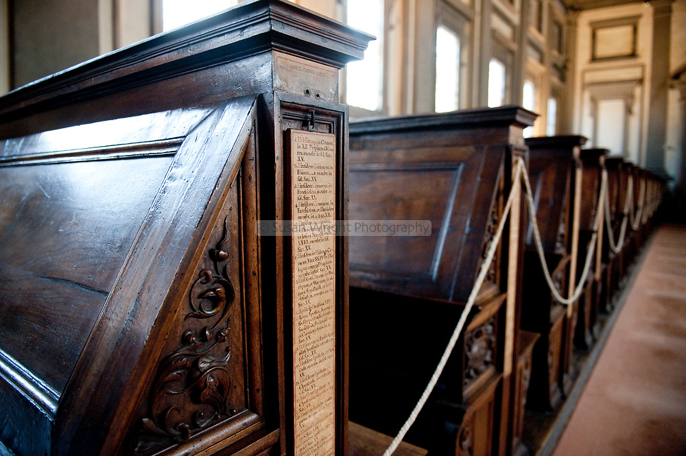 Insription details of manuscripts along the walnut benches in the reading room, Biblioteca Medicea Laurenziana, Florence, Italy