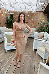 LEAH WELLER at the Warner Music Group Summer Party in association with British GQ held at Shoreditch House, Ebor Street, London E2 on 8th July 2015.