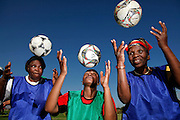 Football practice with the Gogo's ( Zulu for granny) football team during the South Africa's 2010 World Cup. Alexandra township. Johannesburg. As well as being a source of exercise the team acts as a community hub for many of the Gogo's. Many of whom are raising orphaned children as a result of the HIV/aids epidemic.