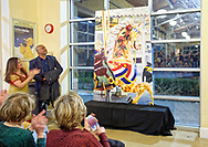 bGarden City, New York, USA. March 9, 2019. Left of mural, DARIEN WARD (Baldwin Civic Association President) and Rita Cavanagh (Baldwin Civic Association Beautification Committee Chair) look at mural as audience applauds after he and the artist Michael White uncovered painting, a close-up of a Nunley's Carousel horse, at Unveiling Ceremony. Event was held at historic Nunley's Carousel in its Pavilion on Museum Row on Long Island.