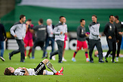Legia's Jakub Kosecki lies on the pitch after the UEFA Champions League play-off second leg match between Legia Warsaw and FC Steaua Bucuresti at Pepsi Arena Stadium in Warsaw on August 27, 2013.<br /> <br /> Poland, Warsaw, August 27, 2013<br /> <br /> Picture also available in RAW (NEF) or TIFF format on special request.<br /> <br /> For editorial use only. Any commercial or promotional use requires permission.<br /> <br /> Photo by &copy; Adam Nurkiewicz / Mediasport