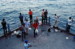 TURKEY ISTANBUL JUL02 - Turkish hobby fisherman try their luck off a pillar of Galatay Bridge which spans the Golden Horn and connects Old Istanbul with outer parts of town...jre/Photo by Jiri Rezac..© Jiri Rezac 2002..Contact: +44 (0) 7050 110 417.Mobile:   +44 (0) 7801 337 683.Office:    +44 (0) 20 8968 9635..Email:     jiri@jirirezac.com.Web:     www.jirirezac.com