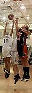 Fairmont's Abby Dalton (11) and Cassie Sant go airborne with Beavercreek's Mikaela Ruef (44) as the Beavercreek Lady Beavers take on Kettering's Fairmont High School Lady Firebirds Wednesday night, January 31, 2007.